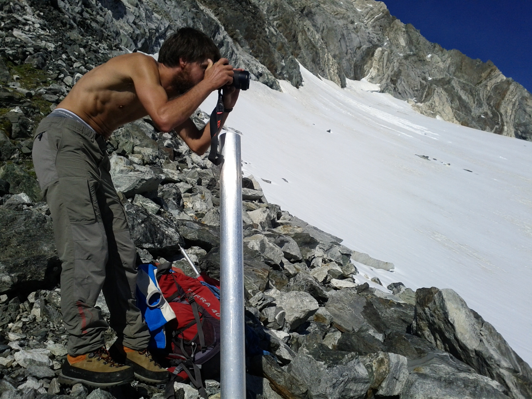 Beno photograph​ing the Vazzeda Glacier from the measuring post.