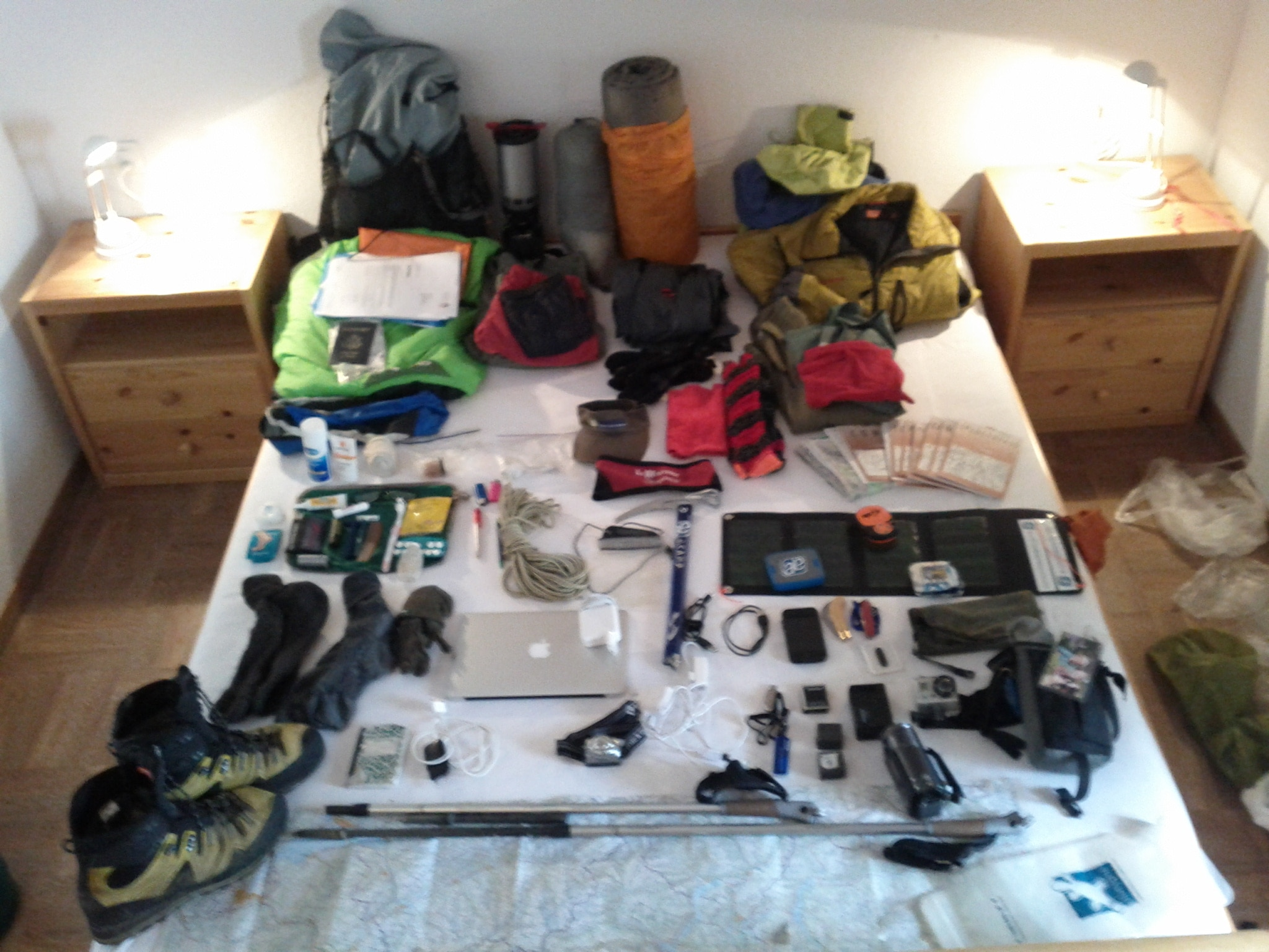 After the purge. Today I stripped out all of my climbing gear except 15 meters of rope and an aluminum ice axe. The rest I've mailed on. Here is everything I'm carrying and wearing, right down to my underwear. Plus food for several days. And water. And the phone-came​ra I'm taking this picture with.