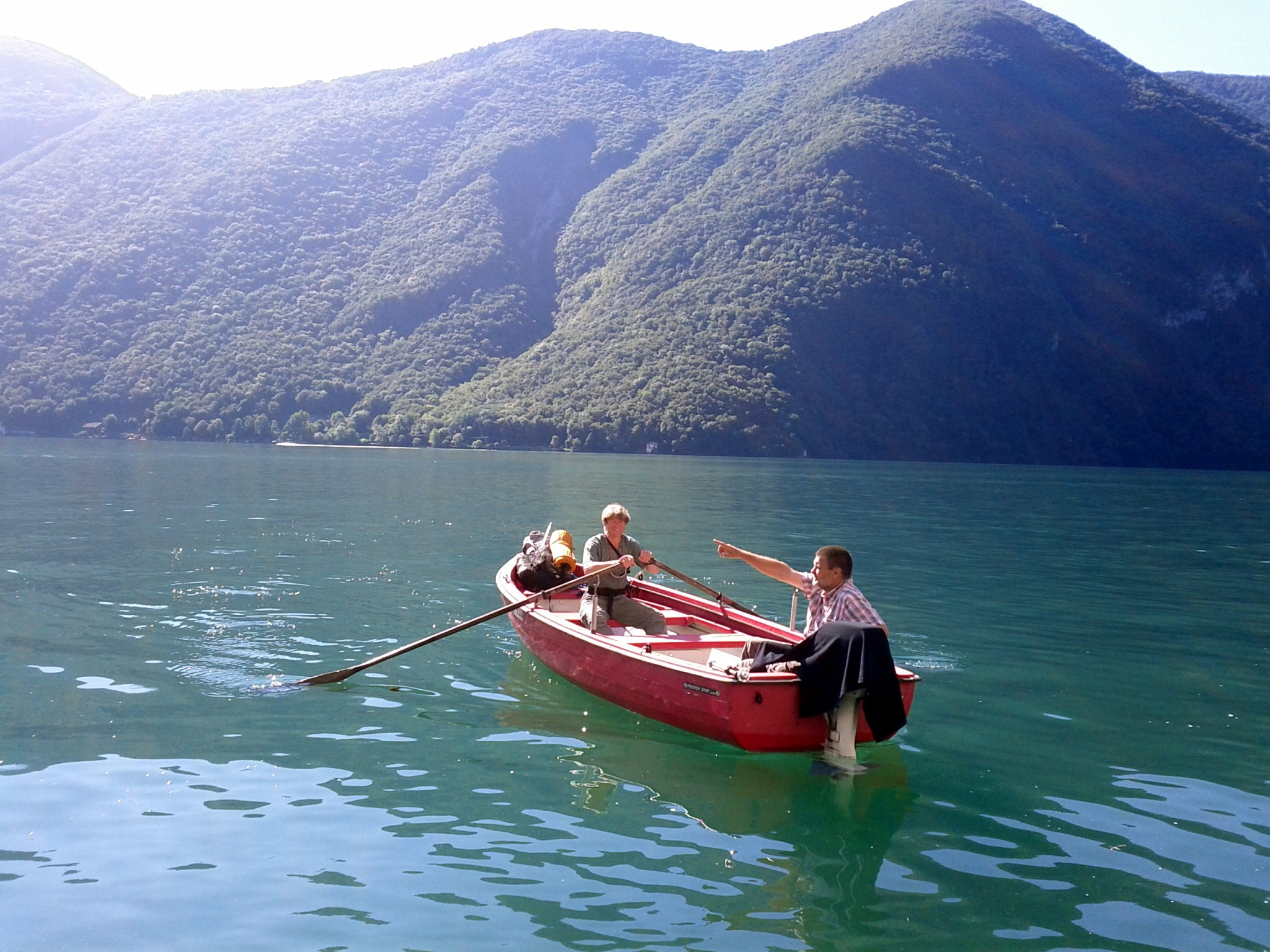Leaving Gandria by rowboat with Roland Baumgartne​r, my great aid in all things logistical​.