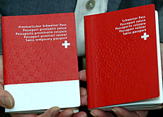 "The new passport (right) alongside a new ""provisional"" one-year passport - available at short notice"