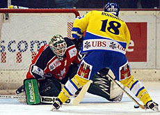 HC Davos player Lonny Bohonos score the team's second goal - not enough to win the Spengler Cup.