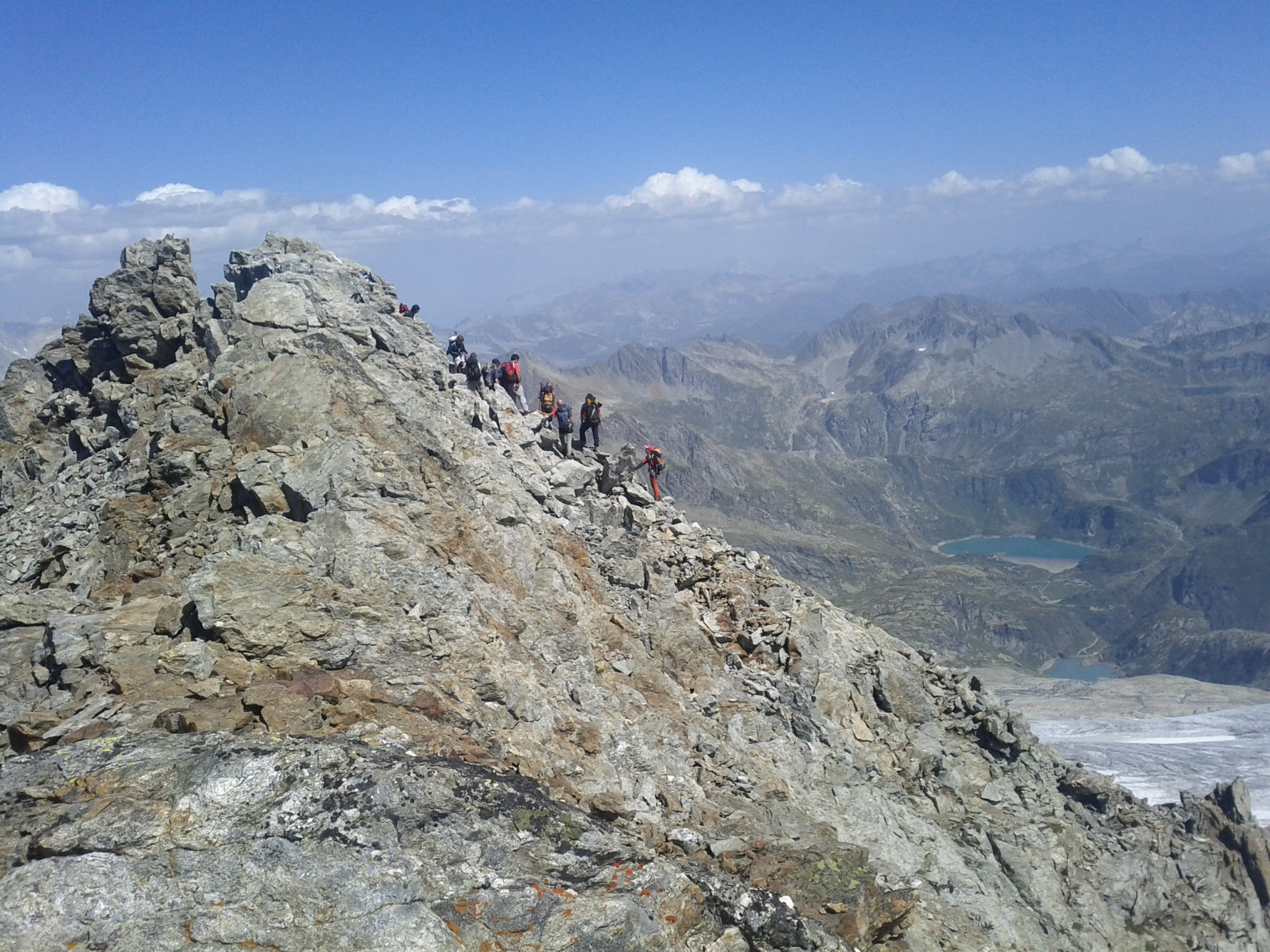 A family and friends descend from the summit of Basòdino.