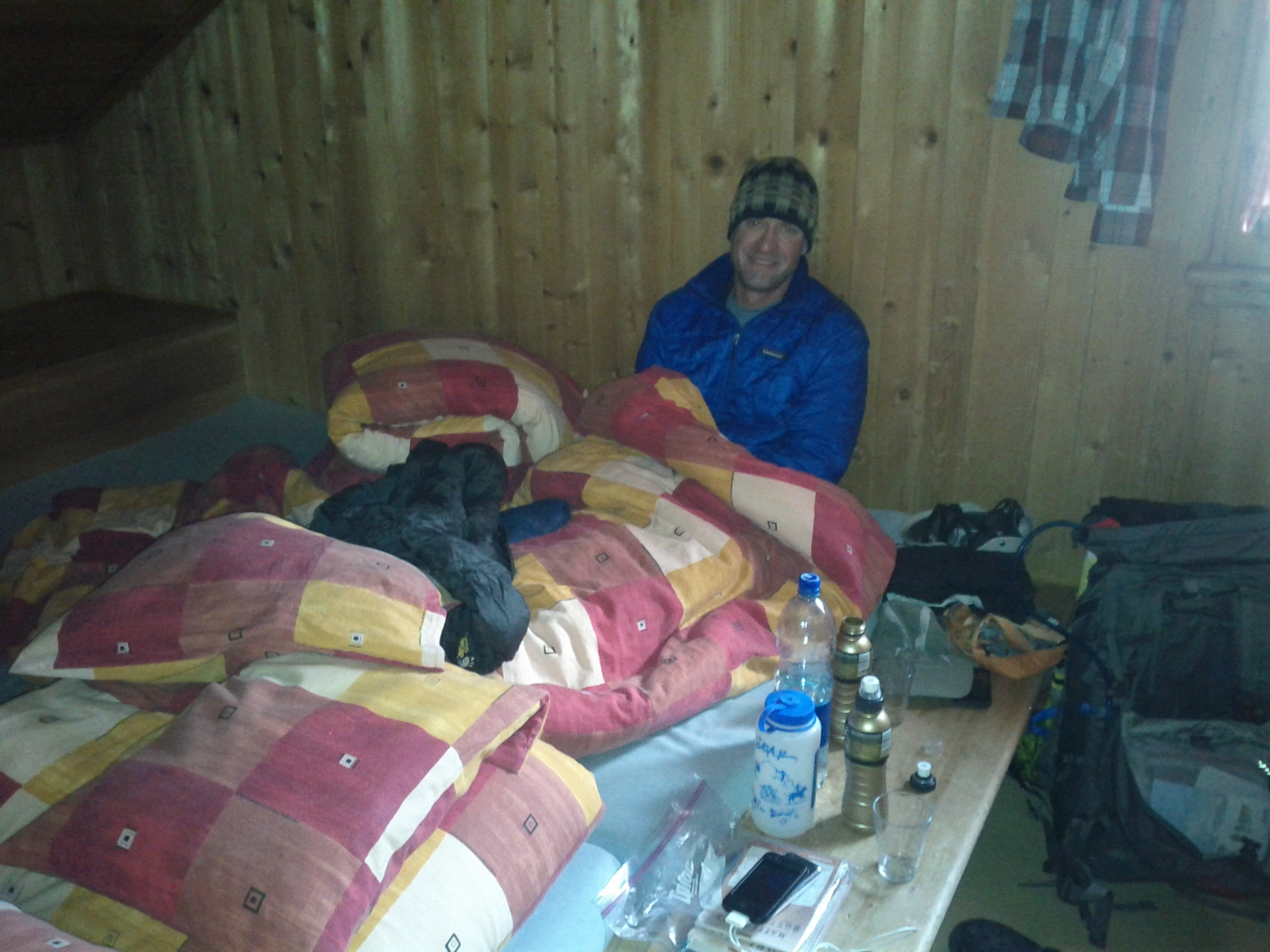 John Bird shivering and trying to rehydrate at the Schönbiel​hütte prior to descending to Zermatt.