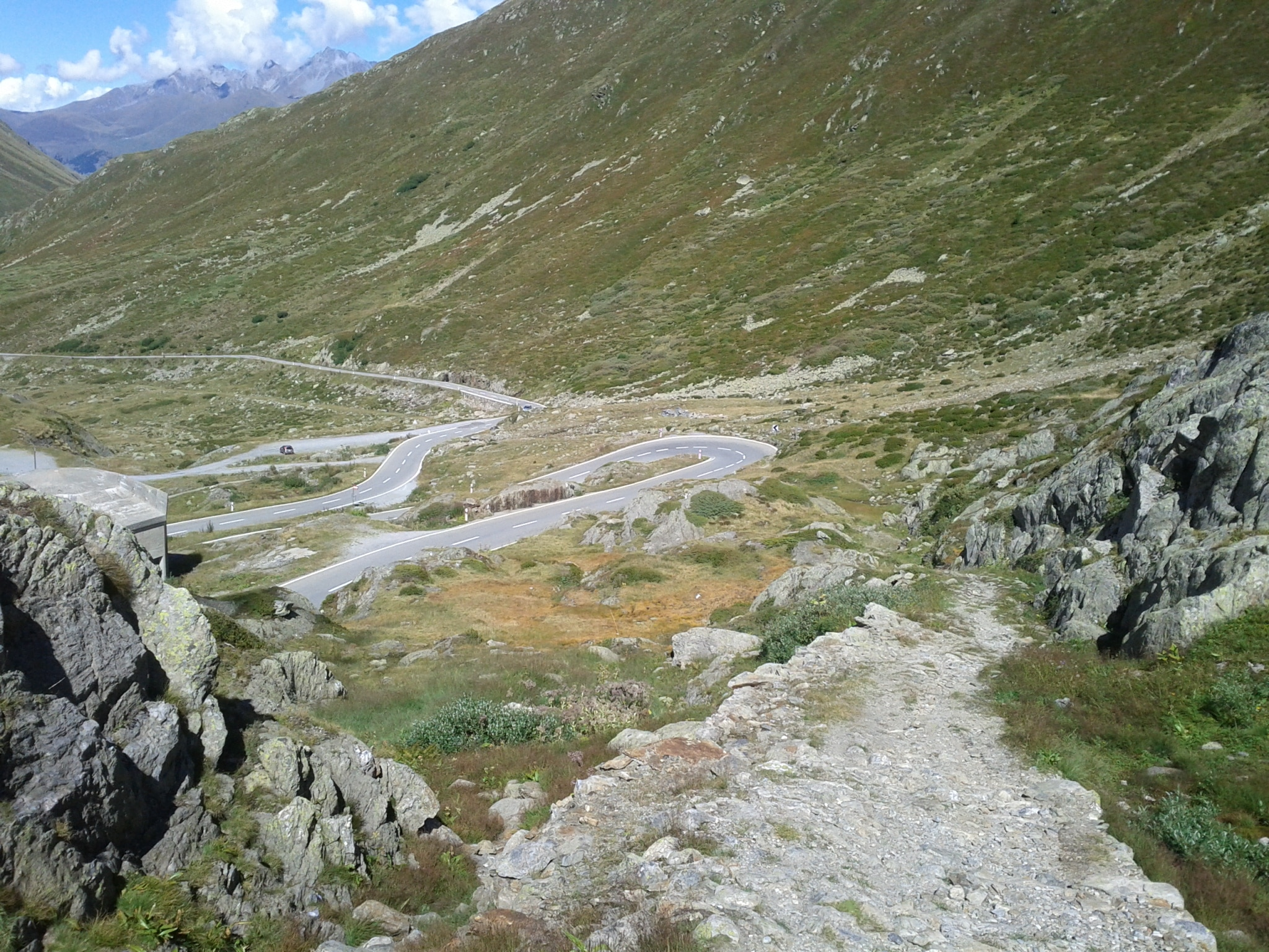 The centuries old road to the St Bernard pass versus the switchback pavement of modern days.
