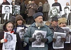 Belarus activists with pictures of people who have disappeared under Lukashenko's regime