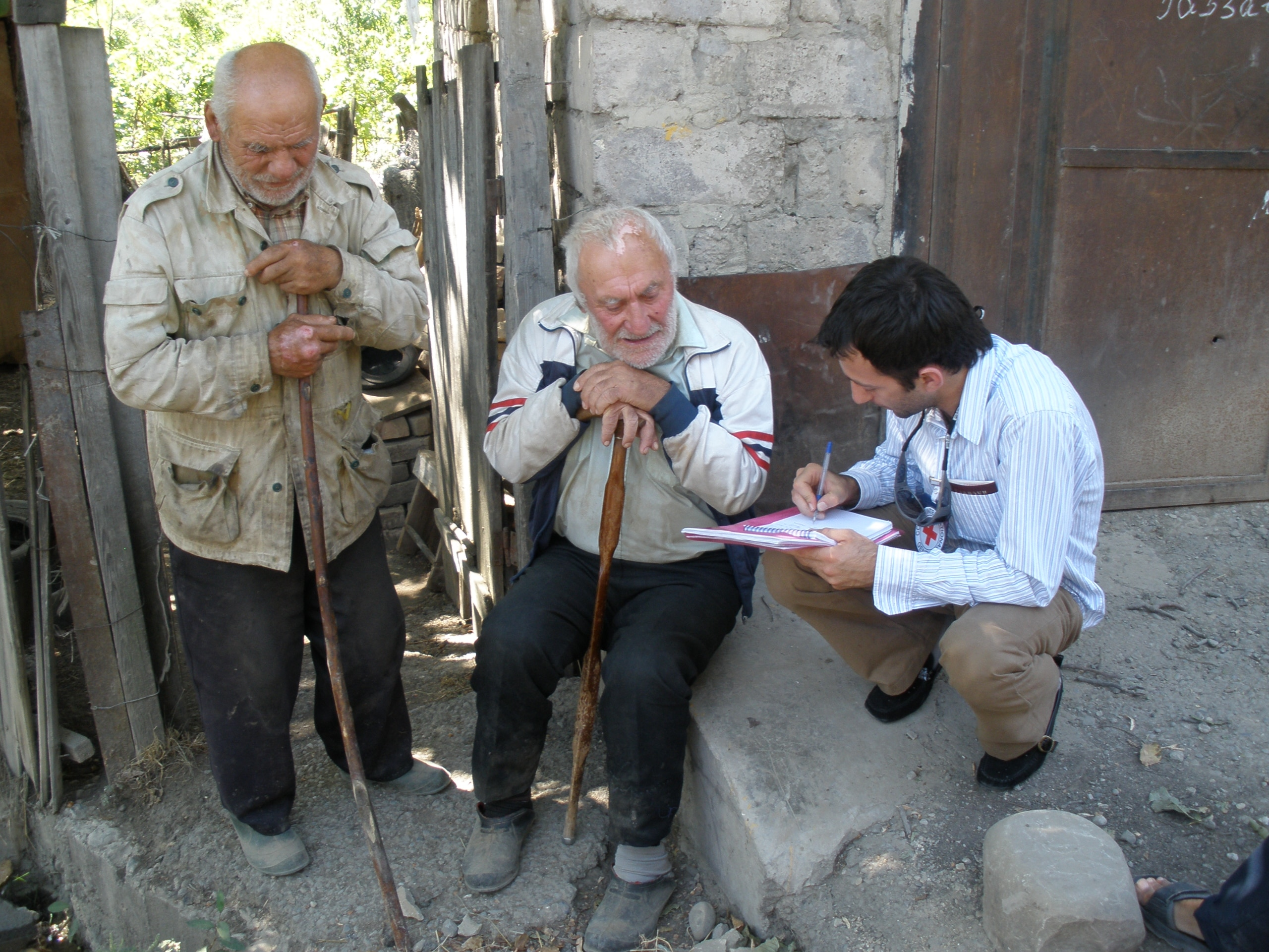 Tskhinvali, Georgia. An ICRC staff member writes Red Cross messages for elderly people separated from their families. (©ICRC/A. Isyuk)
