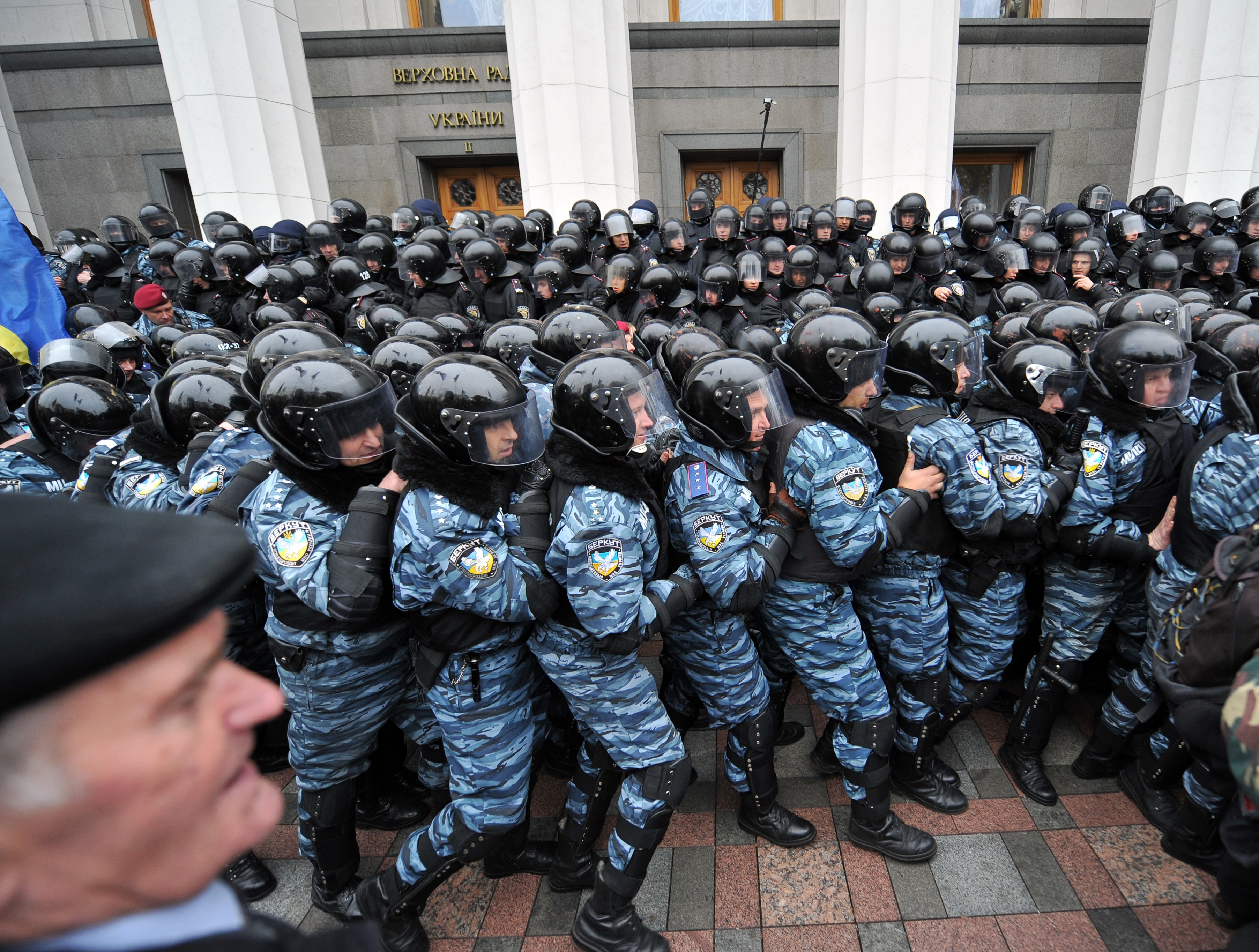 Riot policemen block supporters of different opposition parties in front of the Ukrainian parliament in Kiev on November 3, 2011.