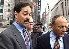 Former CSFB banker Frank Quattrone (left) has been charged with obstructing justice