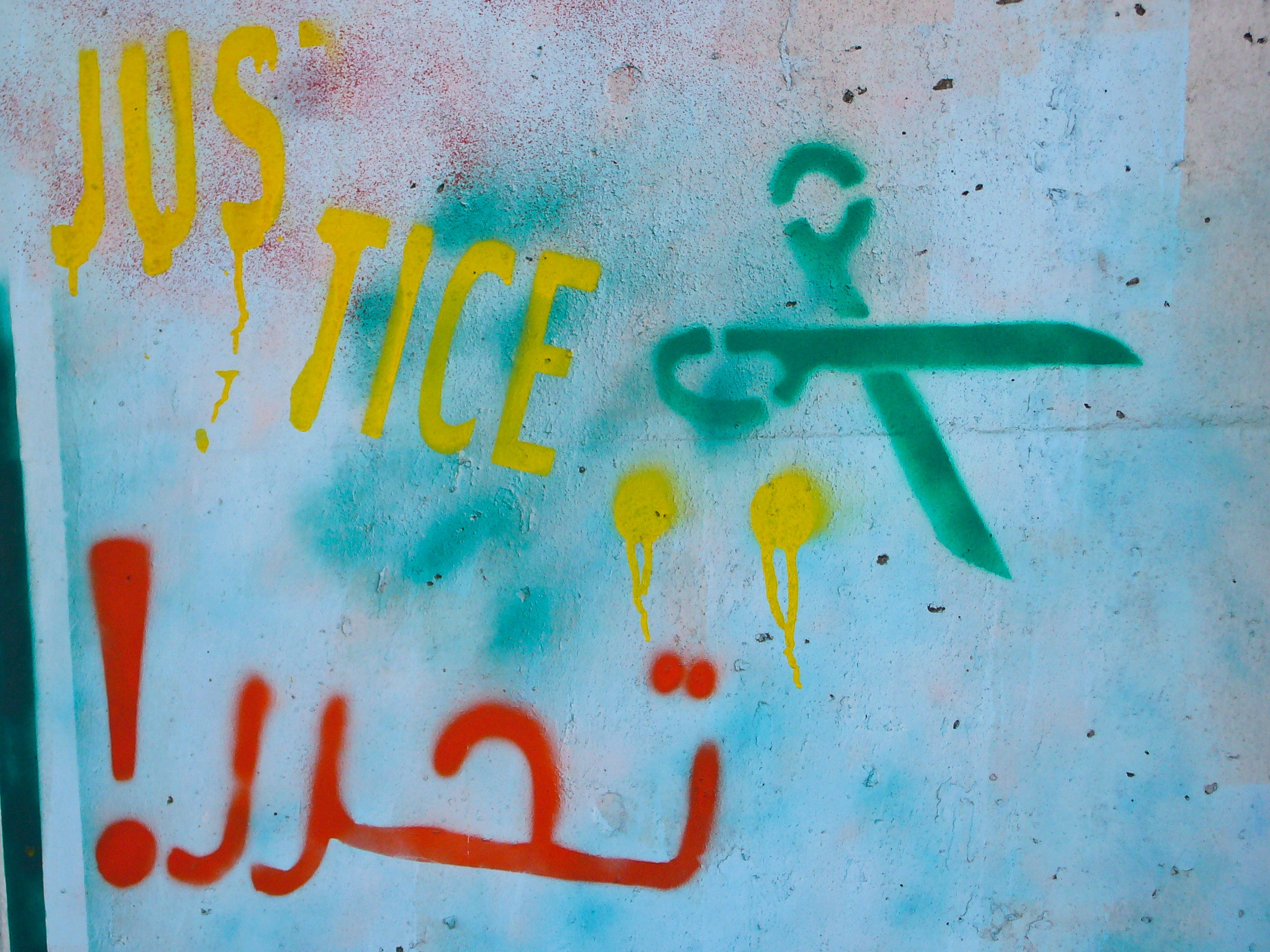 "The word ""justice"" in French and ""liberation!"" in Arabic - two of the demands of the revolution."