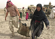 Coalition forces offered to help ensure Swiss aid reached Iraqis