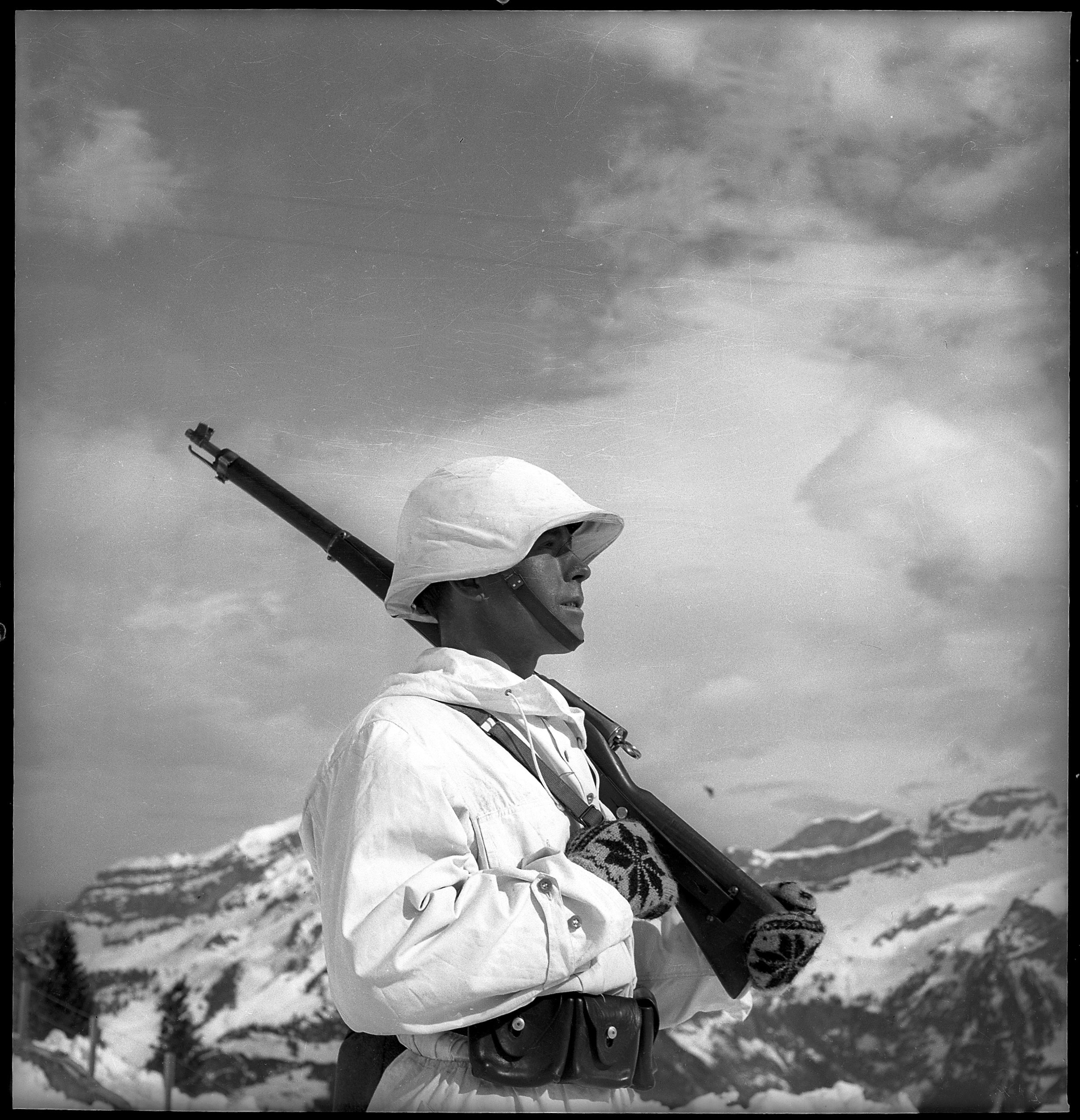 "Swiss mountain soldier, circa 1940  At the beginning of the war, the SWS presented a vision of soldiers as the ""protective guards"" of Switzerland. As the threat of invasion receded, the emphasis was placed on the benefits received by the families of mobilised soldiers, with the idea of promoting solidarity within the country. (Student: Marc Huber)"