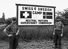 Swiss observers at the entrance to the camp in 1983