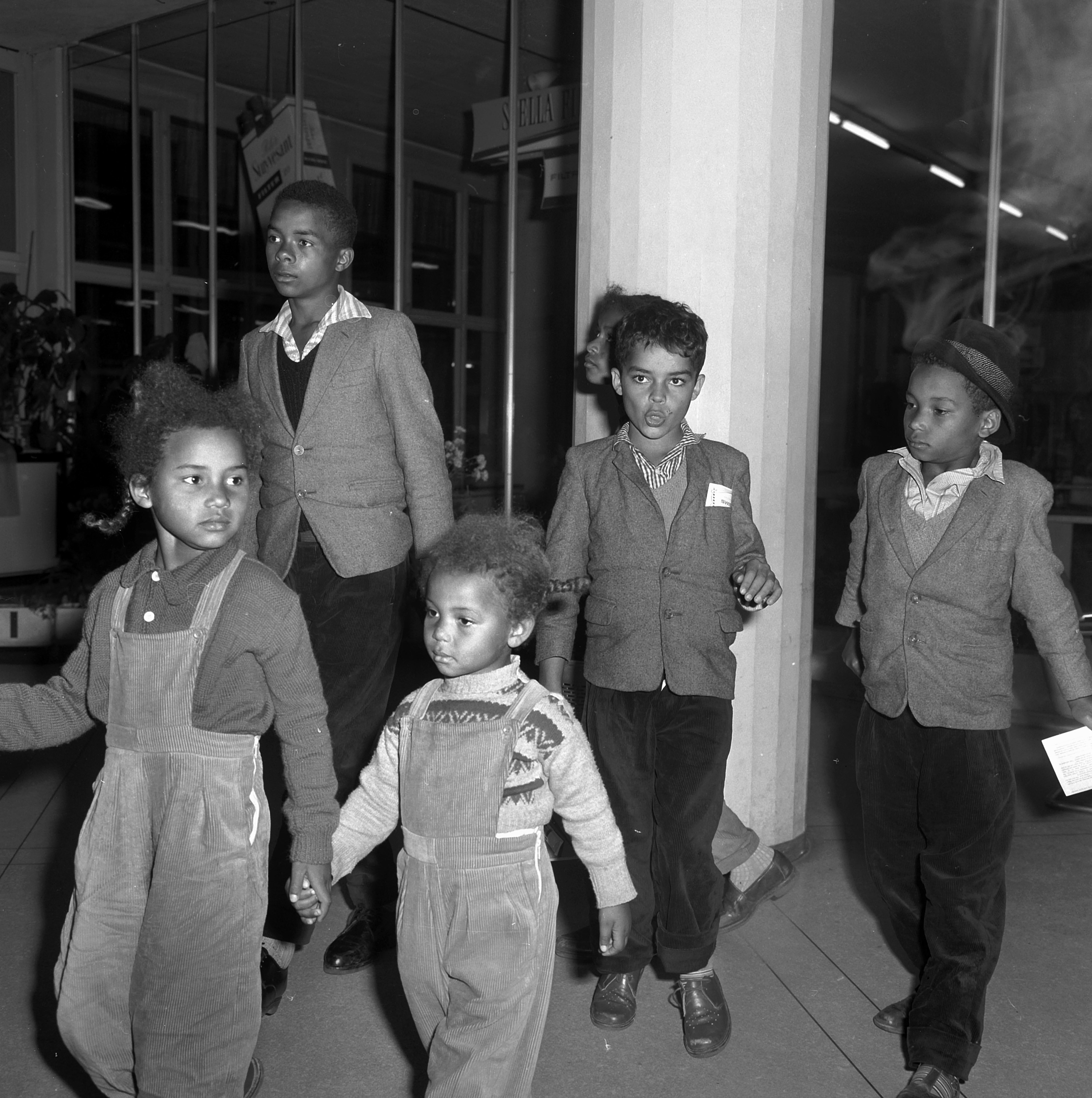 Coming home - children of Swiss emigrants arrive from Congo, 1961.