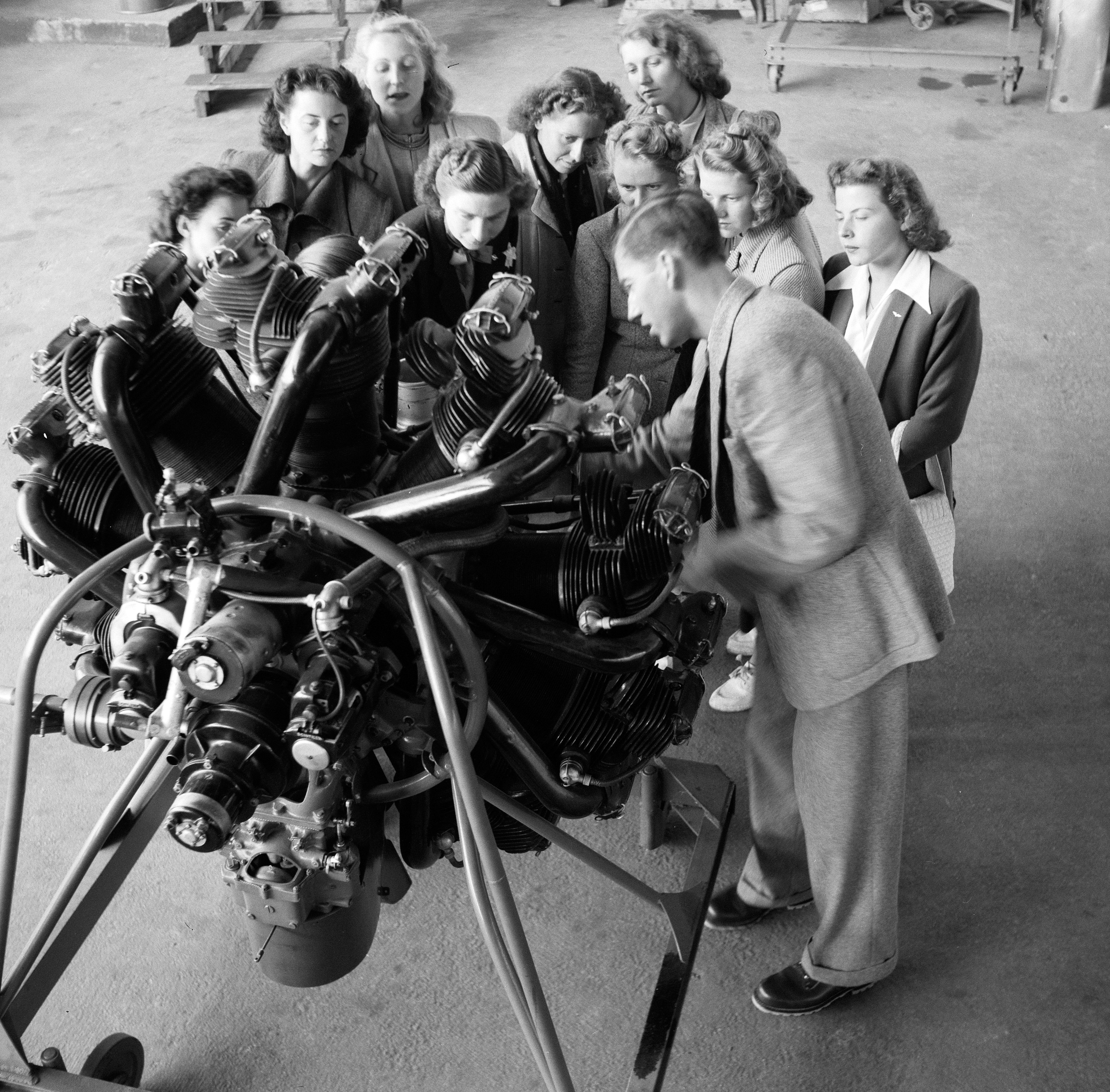 Flight attendants learn about engines, ca. 1948