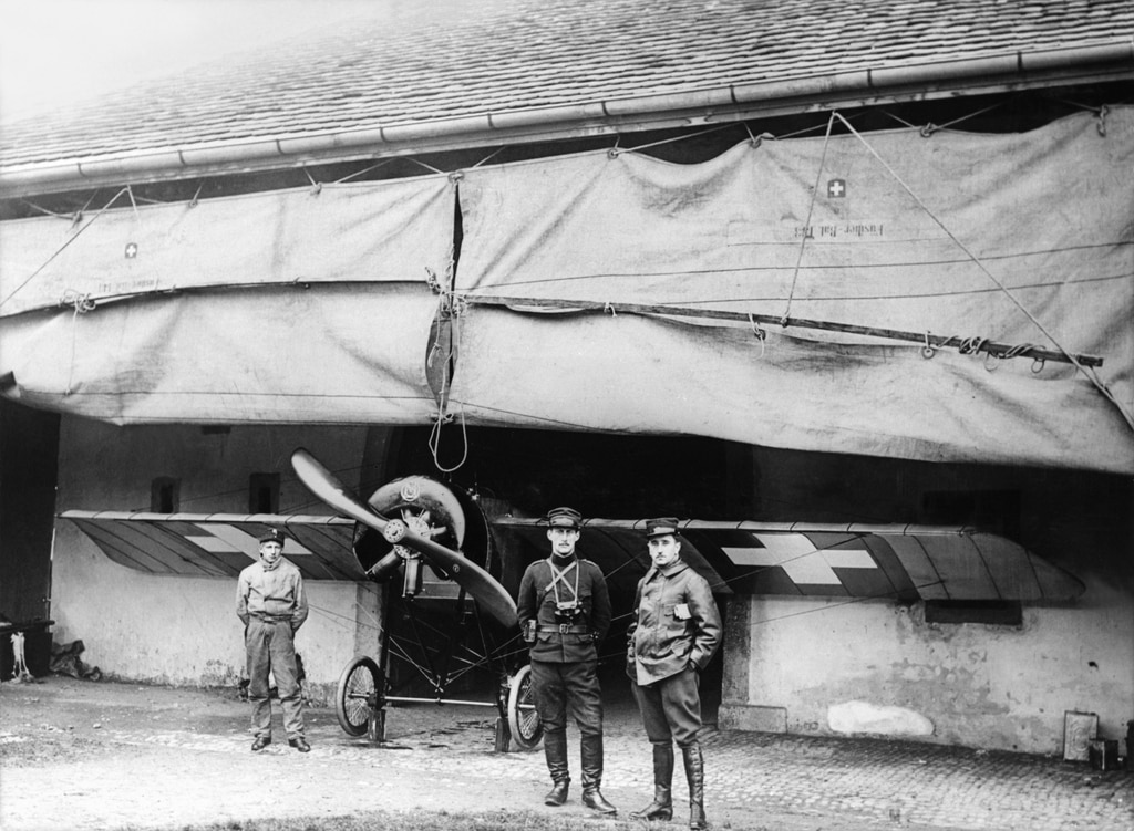 Magnificent men with a flying machine - two Swiss pilots in front of a MS-35 Helene, built in 1913 by the French Morane-Saulnier aircraft manufacturing company.