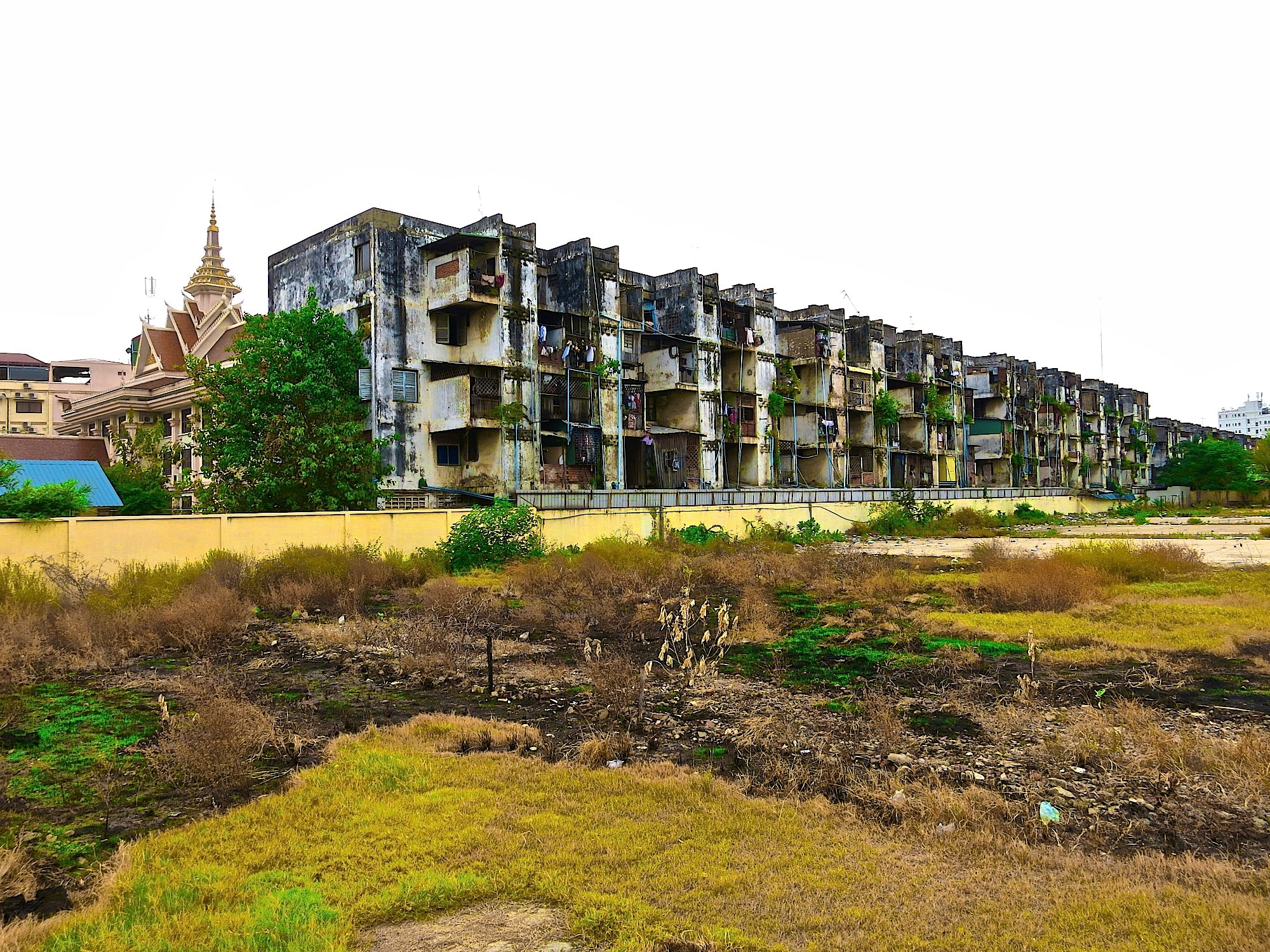 "Known today as the ""white building"", this apartment complex was part of an Olympic village project and later served as housing for teachers and government officials. The Khmer Rouge drove the inhabitants from their homes during their rise to power in the 1970s."