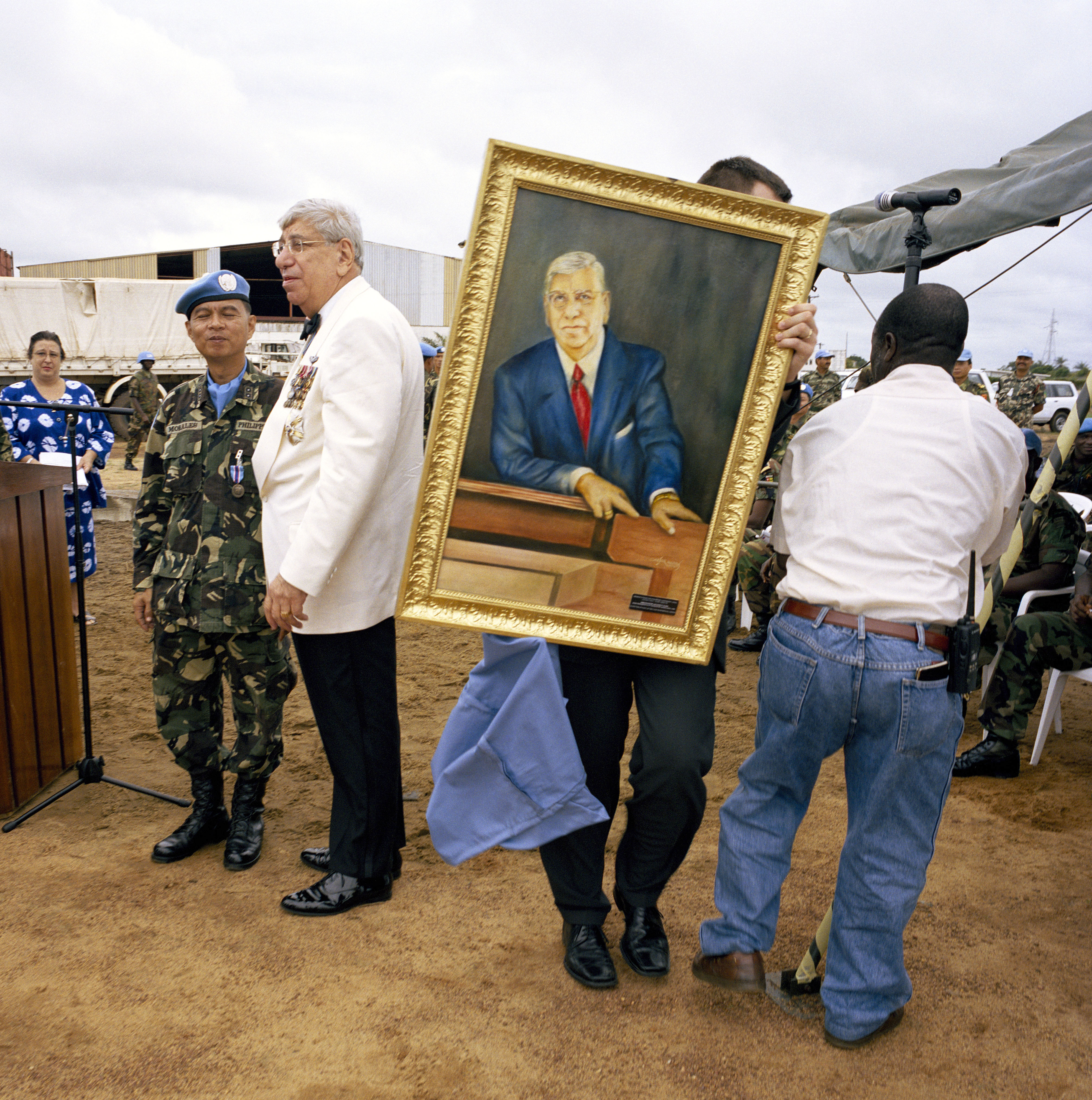 Tim Hetherington / Magnum  Liberia. Monrovia. 2004. Ambassador Jacques Klein, the UN's special representative of the secretary-general, receives a portrait of himself from the Fillipino contingent at a parade to mark the end of its tour of duty.
