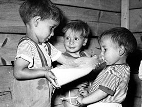 Children receive milk from Unicef during in the post-war years in Italy