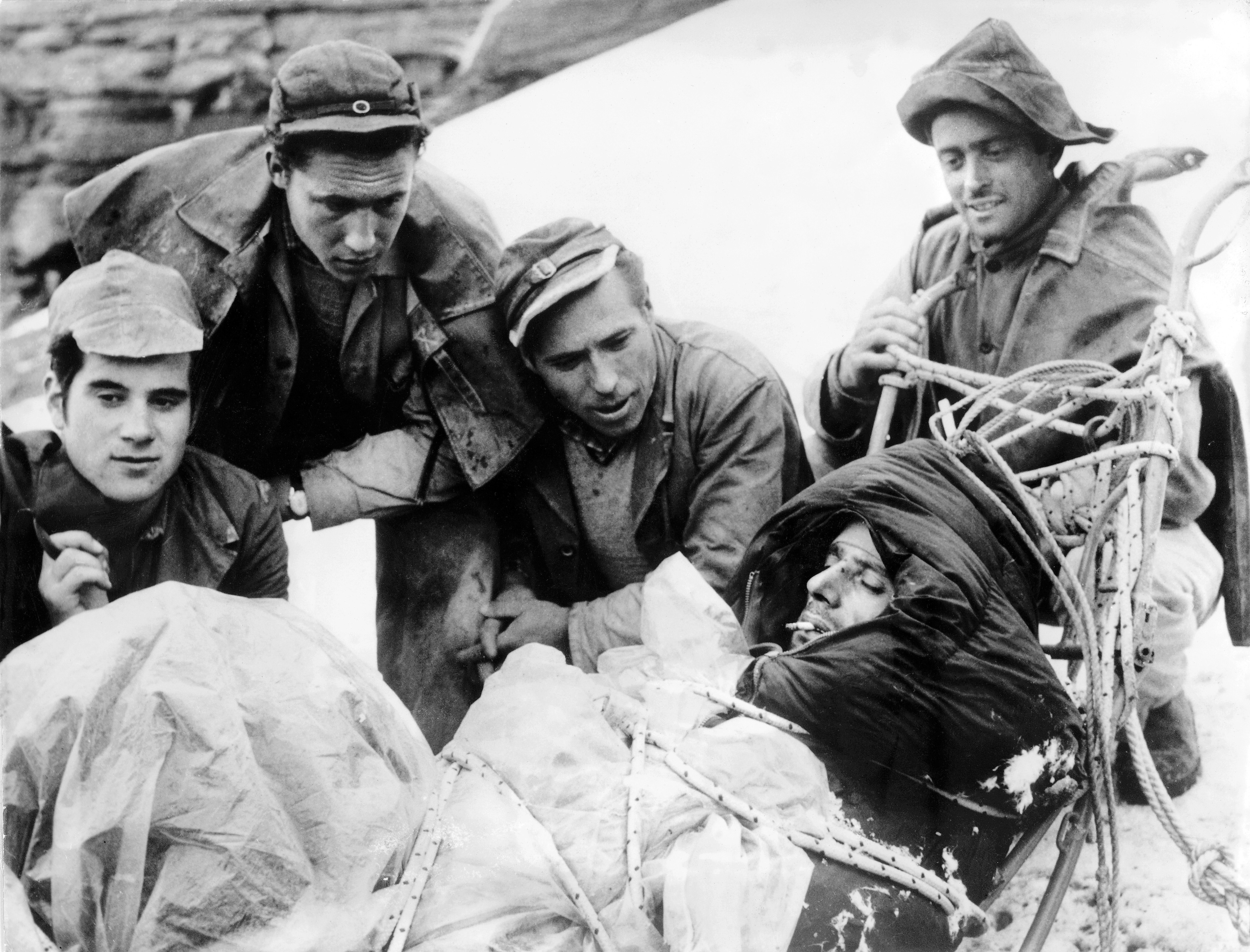 Italian construction workers employed by the Jungfrau Railway show their relief at the successful rescue of their compatriot.
