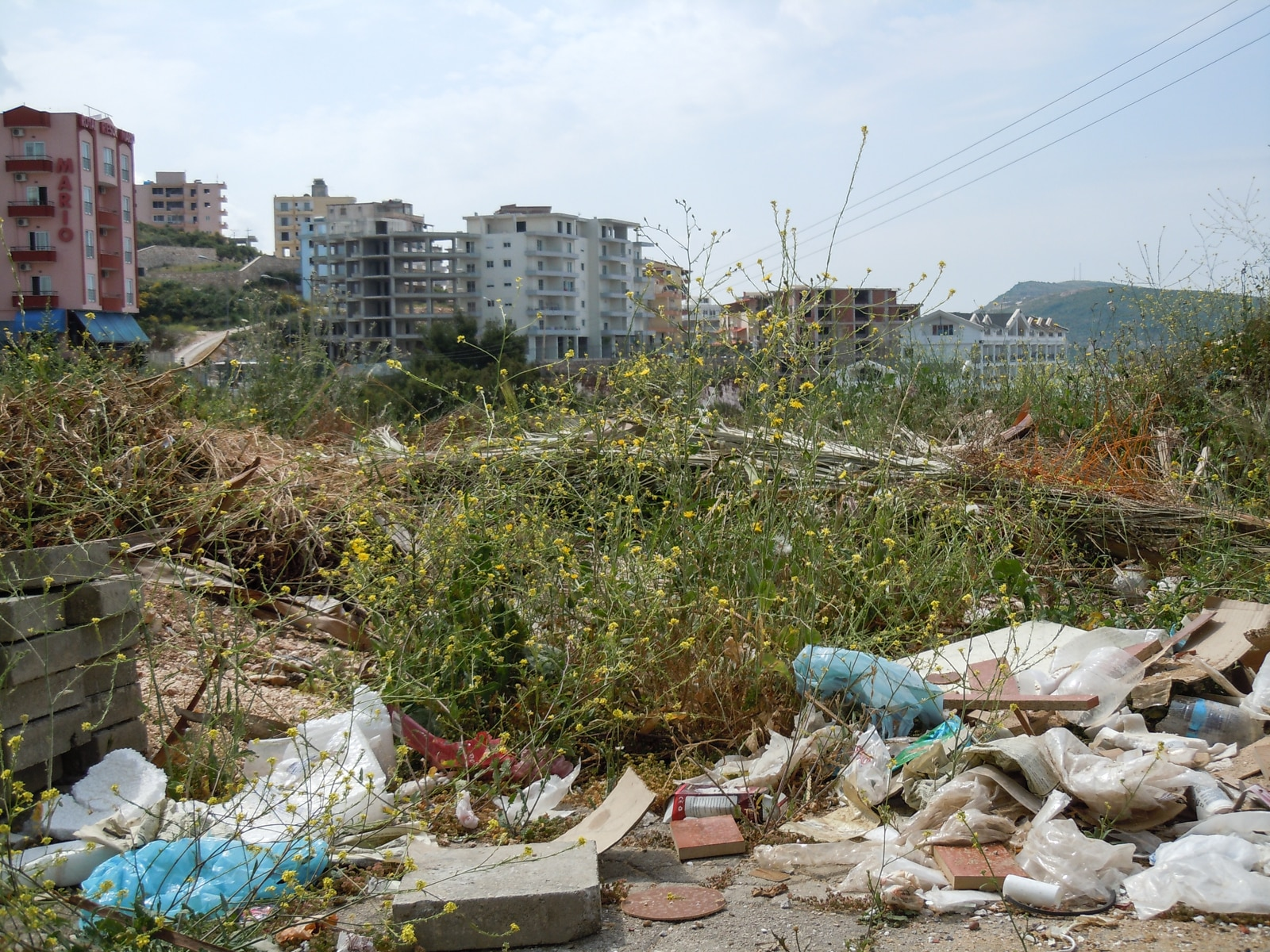 Saranda in the south: piles of rubbish and recently built blocks of flats as far as the eye can see