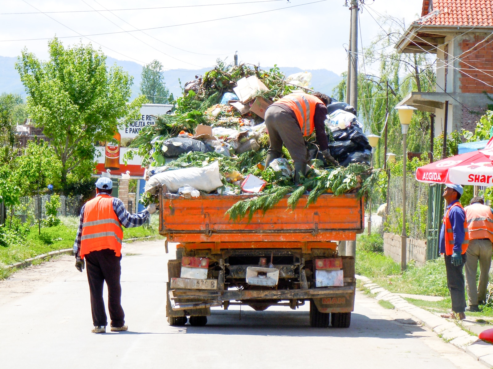 Collecting rubbish by Lake Ohrid, on the border with Macedonia