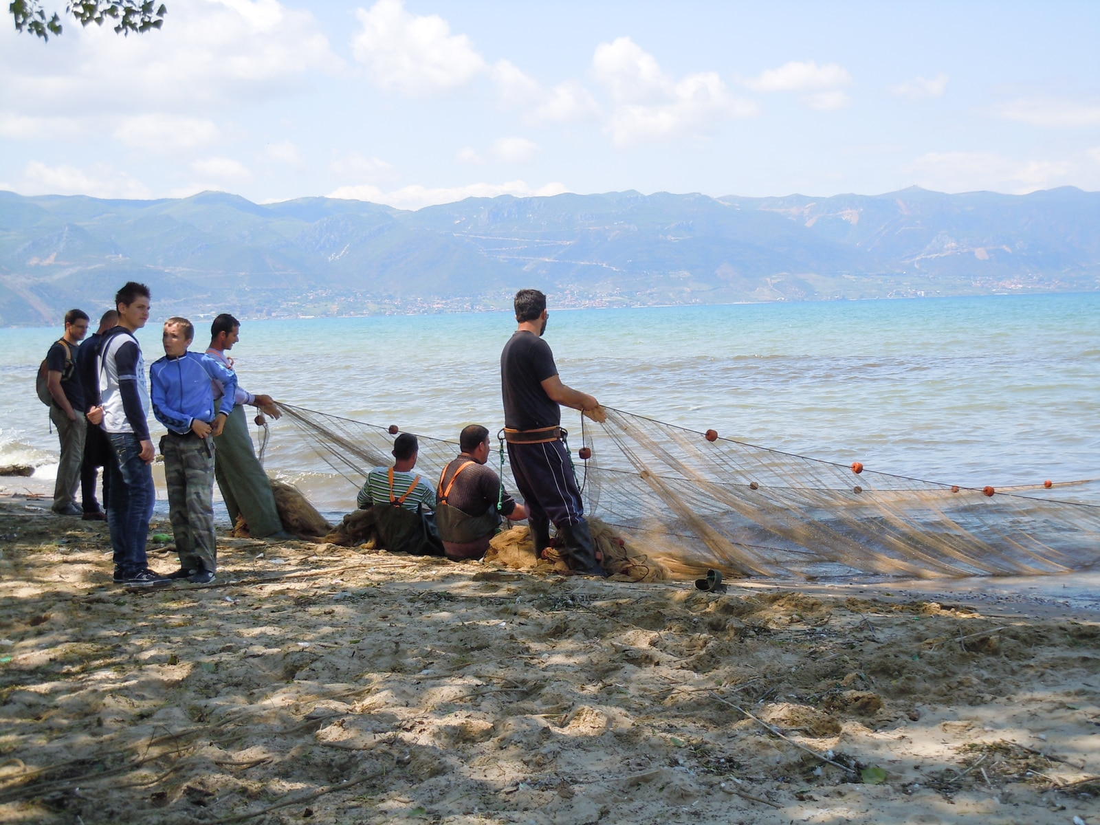 Satisfied with the catch: fishermen near Pogradec on Lake Ohrid