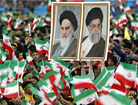 Posters of former leader Ayatollah Khomeini (left) and current Supreme Leader Ayatollah Ali Khamenei on February 10