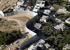 The wall cuts into land occupied by Israel since the 1967 war