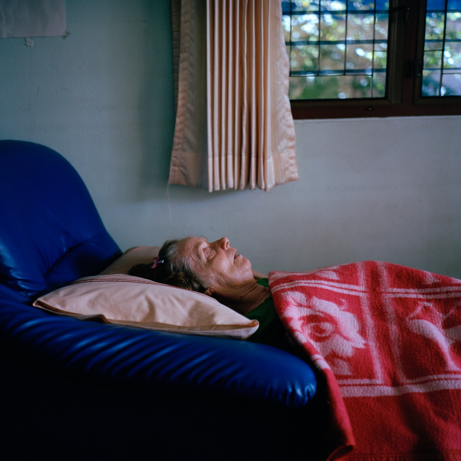 Philippina, 73, has been living at the centre for six years. She likes to spend her afternoons lying on the couch.