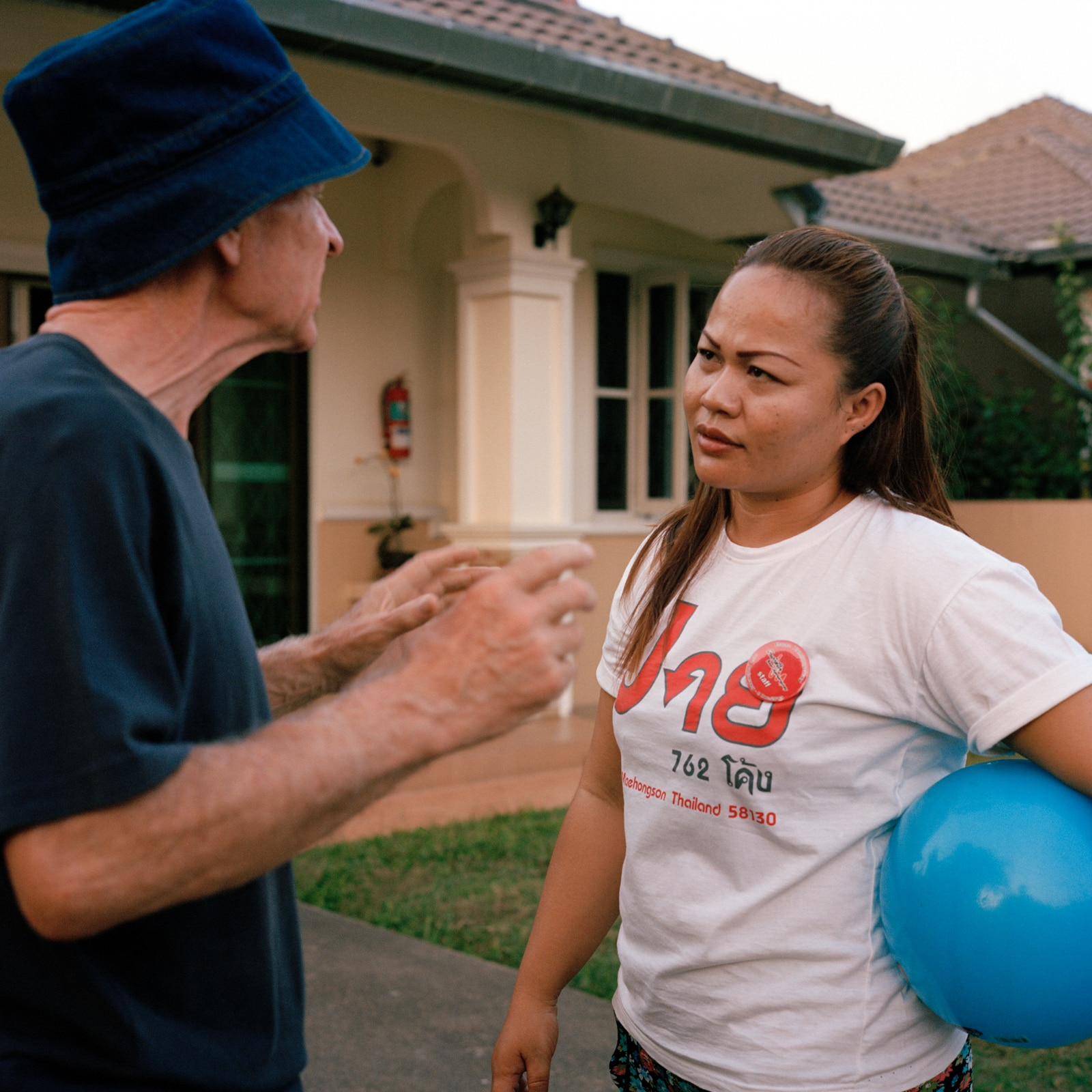 Geri, 65, and Nong, after playing ball. Even though they don't speak the same language, communication is sincere. Geri needs to move and express himself all the time, but what he says is incomprehensible. But unlike in Switzerland, residents are not given tranquilisers.