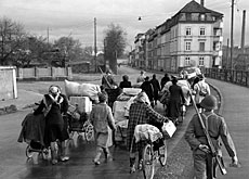 Refugees arriving at the Swiss border near Basel in 1944