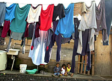 Children waiting outside their home in a shantytown in Sao Paulo