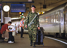 A recruit heads home with his rifle