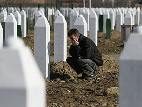 A Bosnian Muslim at the memorial centre near Srebrenica, where as many as 8,000 Muslim men and boys were slaughtered by Serbs