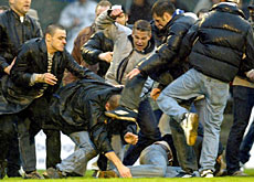 Rival fans clash at the Swiss Cup final in 2002