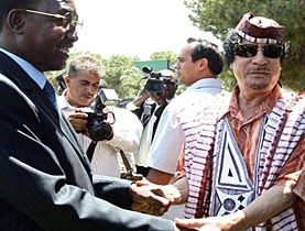 Gaddafi (right) meets Chad's president Deby in Tripoli on August 8, 2009