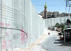 Israel's barrier near the Jerusalem suburb of Abu Dis is 13 metres high