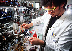 A chemist working in Clariant's Muttenz facility, where many of the cuts will take place