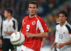 Swiss striker, Alex Frei, in action against Germany, which are also sponsored by a brewery