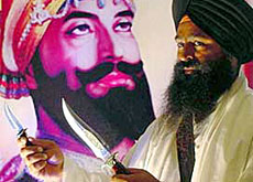 Devout Sikhs normally carry kirpans (tribuneindia.com)