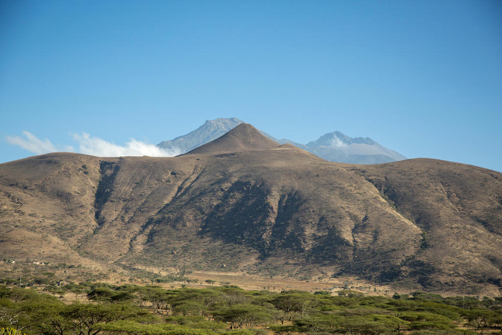 The imposing Mount Meru dormant volcano dominates the Arusha landscape