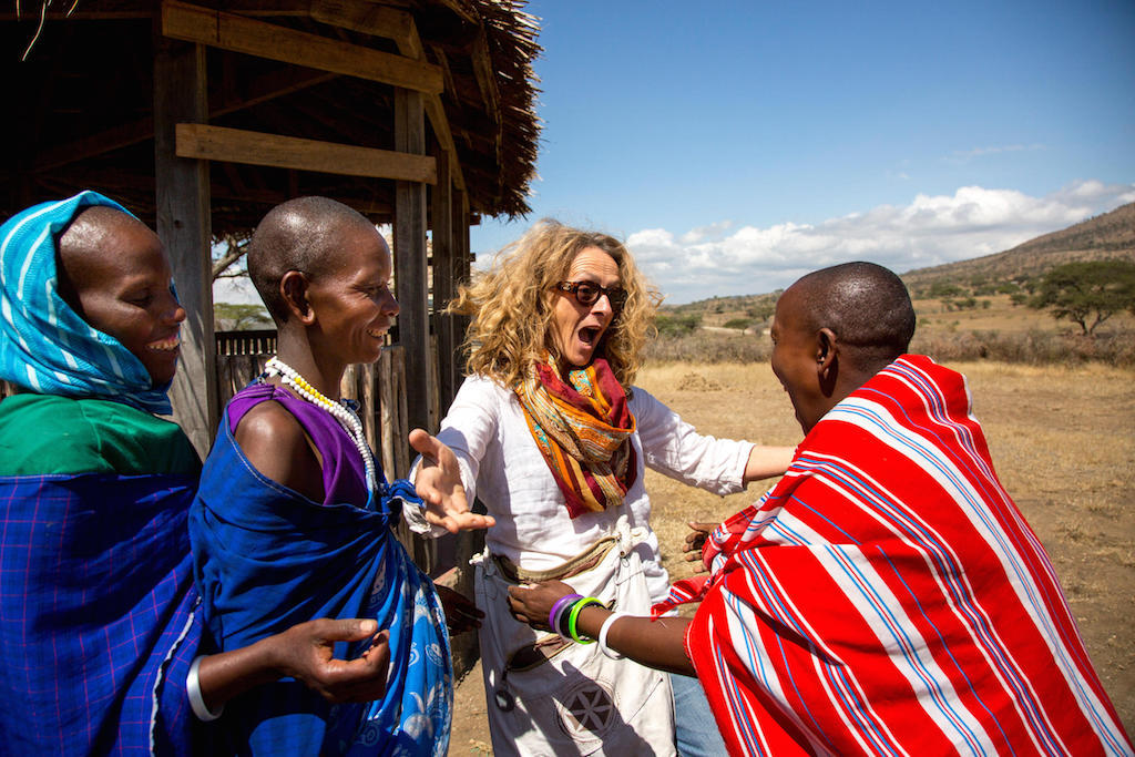 The Masai women look forward to Marina's visit as it means more work and more money for them.