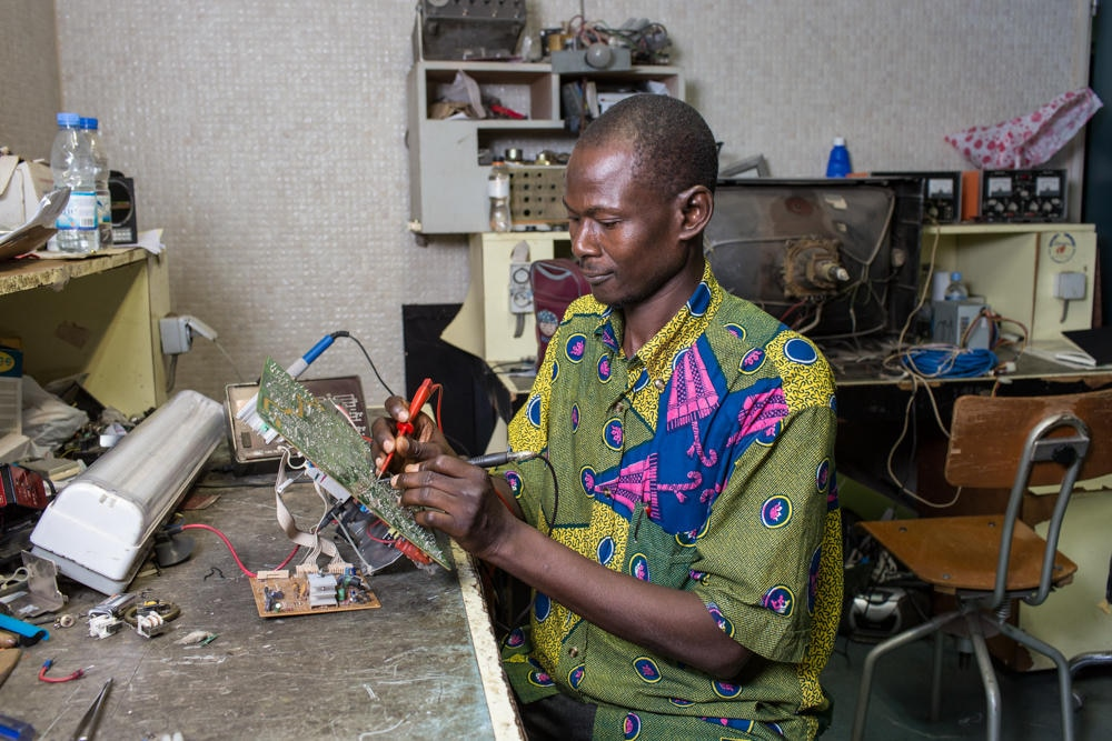 Siaka Dagnogo still repairs old equipment.