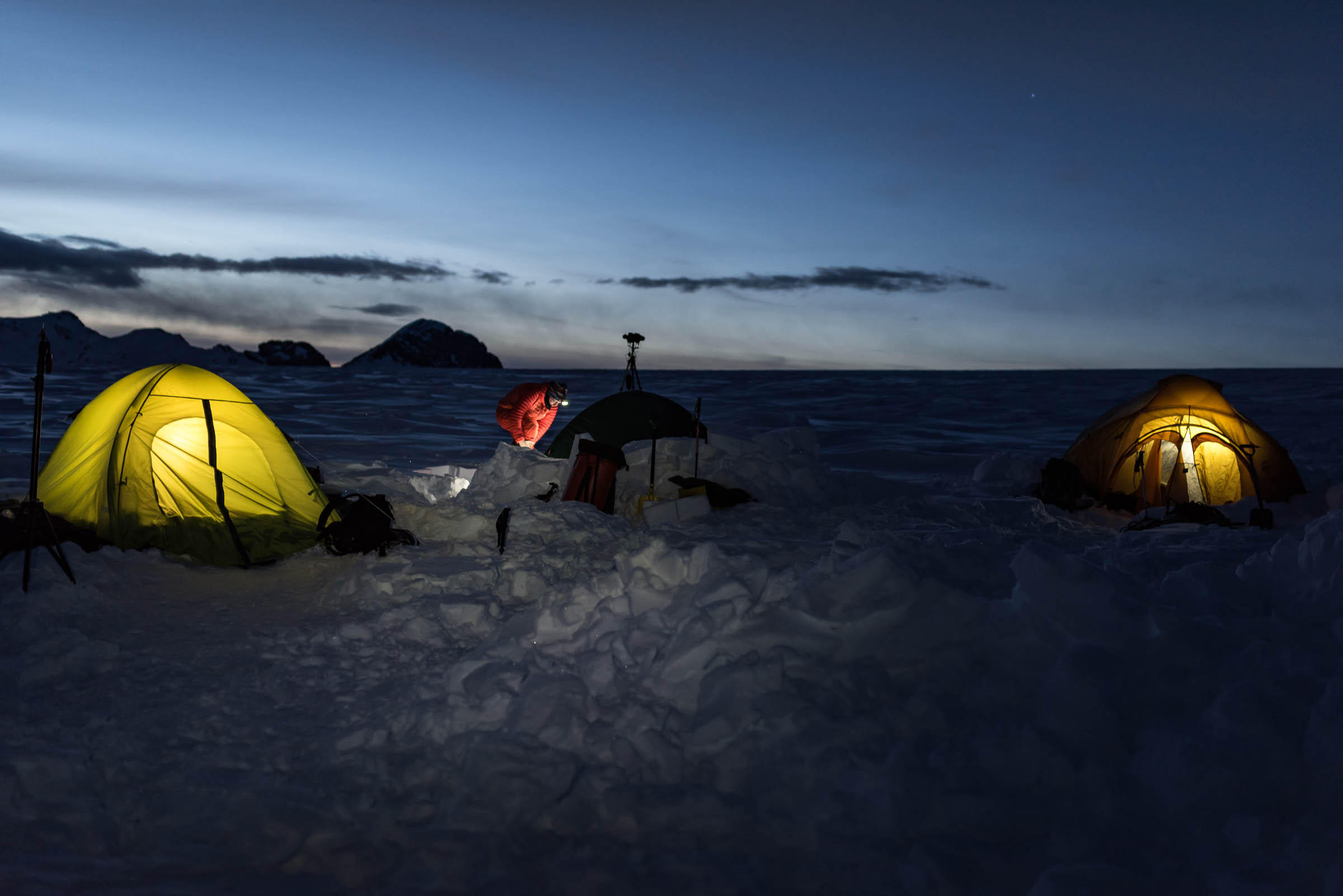 Base camp on the glacier. Photo taken at night with lights in tents.