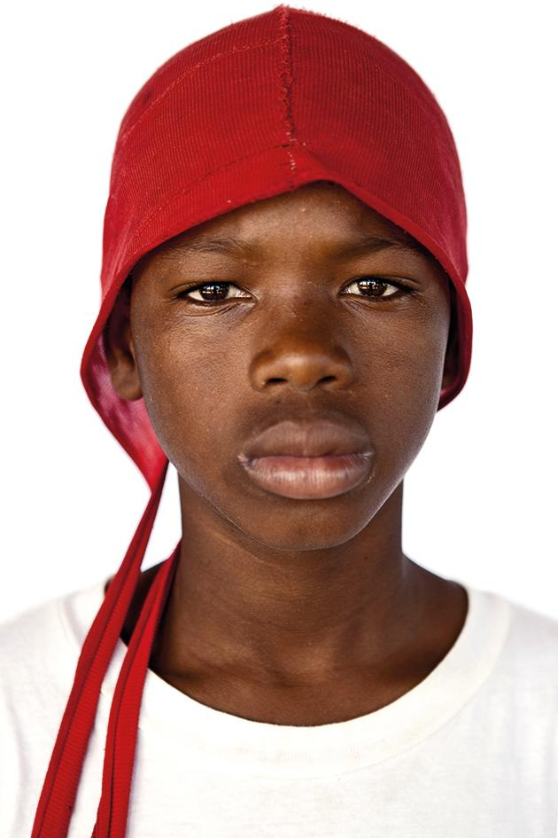 Boy wear a red hat, Razza Umana, 2016