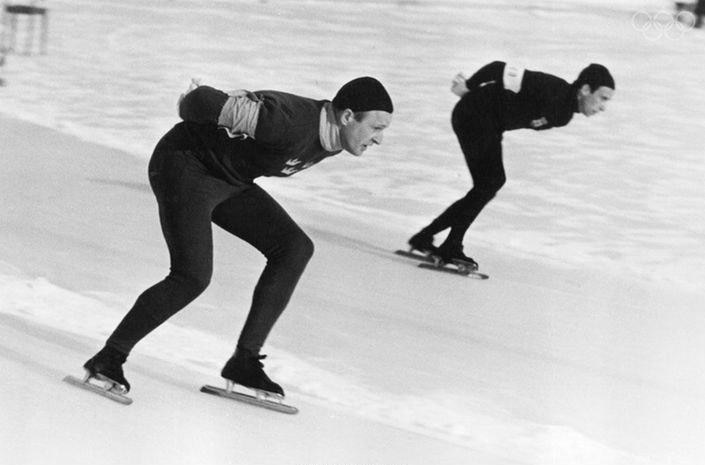 Two men speed skating at the 1948 Winter Olympics.