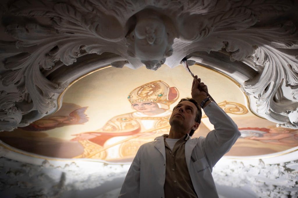 A restorer working on a fresco at the 1400-year-old Disentis Monastery