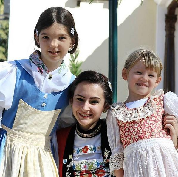 Heidi in traditional costume with two girls in traditional clothes