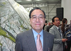 Kunimatsu poses in front of the Swiss pavilion at the 2005 World Expo
