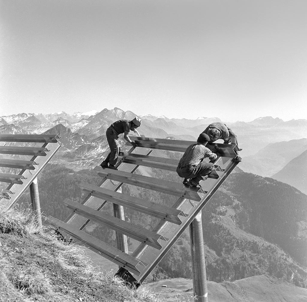 Two men work on the avalanche barriers at Vallascia, Airolo in the canton of Tessin